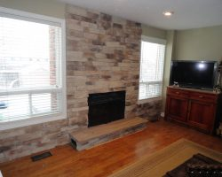 Veneer Wall with Raised Natural Stone Hearth